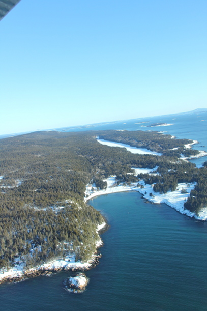 Head Harbor at the southern end of Isle au Haut with Long Pond , a revered wilderness lake in the distance.