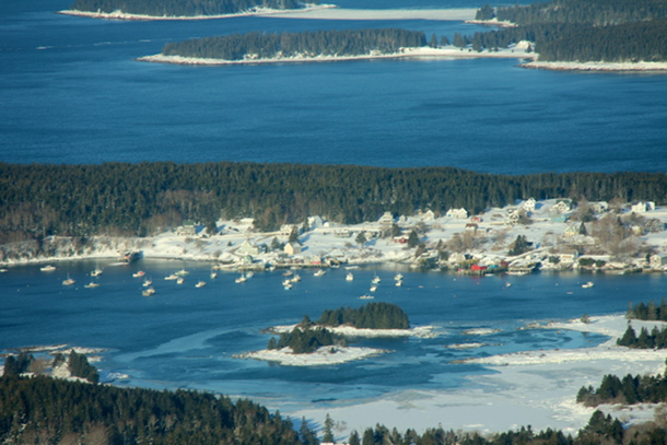 The fleet at Burnt Coat Harbor, Swans Island remains clear of ice.