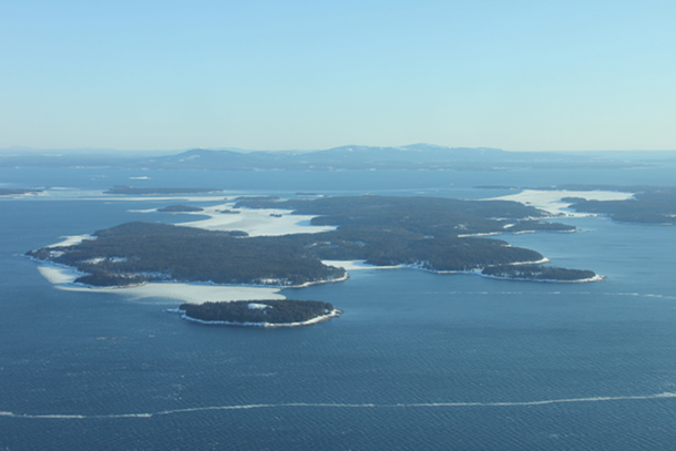 Swans Island with Seal Cove and Mackarel Cove frozen over.  Mount Desert is in the distance.