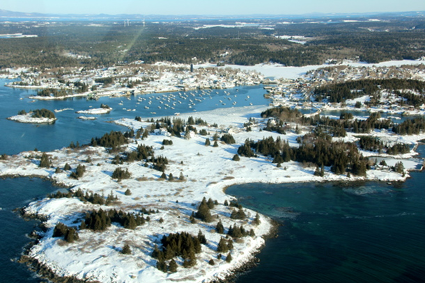 Lane Island and Carver's Harbor, Vinalhaven.  In the distance can be seen the three Fox Islands wind turbines.